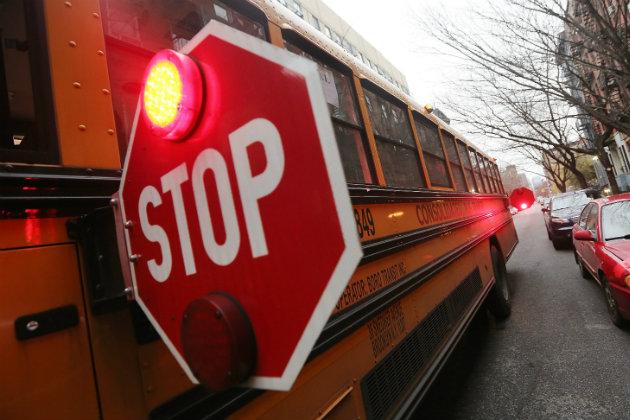 Minivan driver dies in crash with school bus in SE Minnesota
